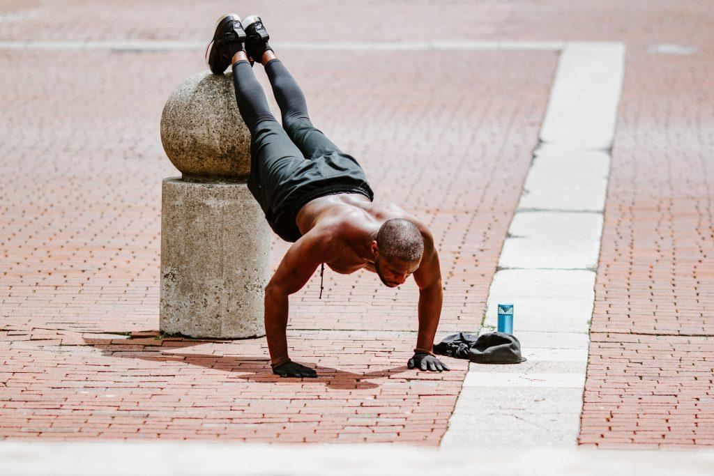 Man doing push ups outside