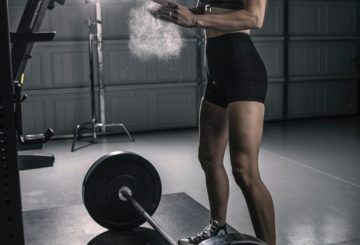Woman training with a barbell at the gym