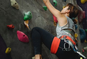 Woman climber on climbing wall