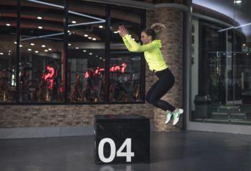 Woman jumping on a plyo box